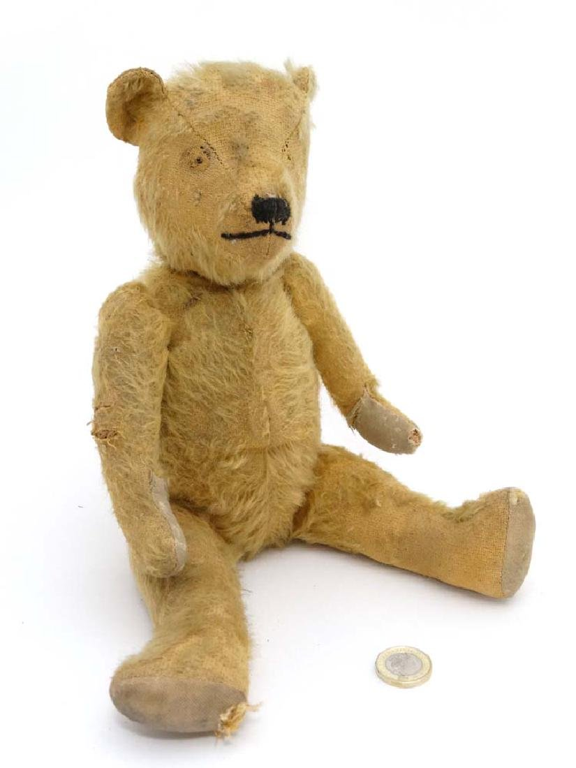 A vintage early 20th C brown mohair teddy bear with