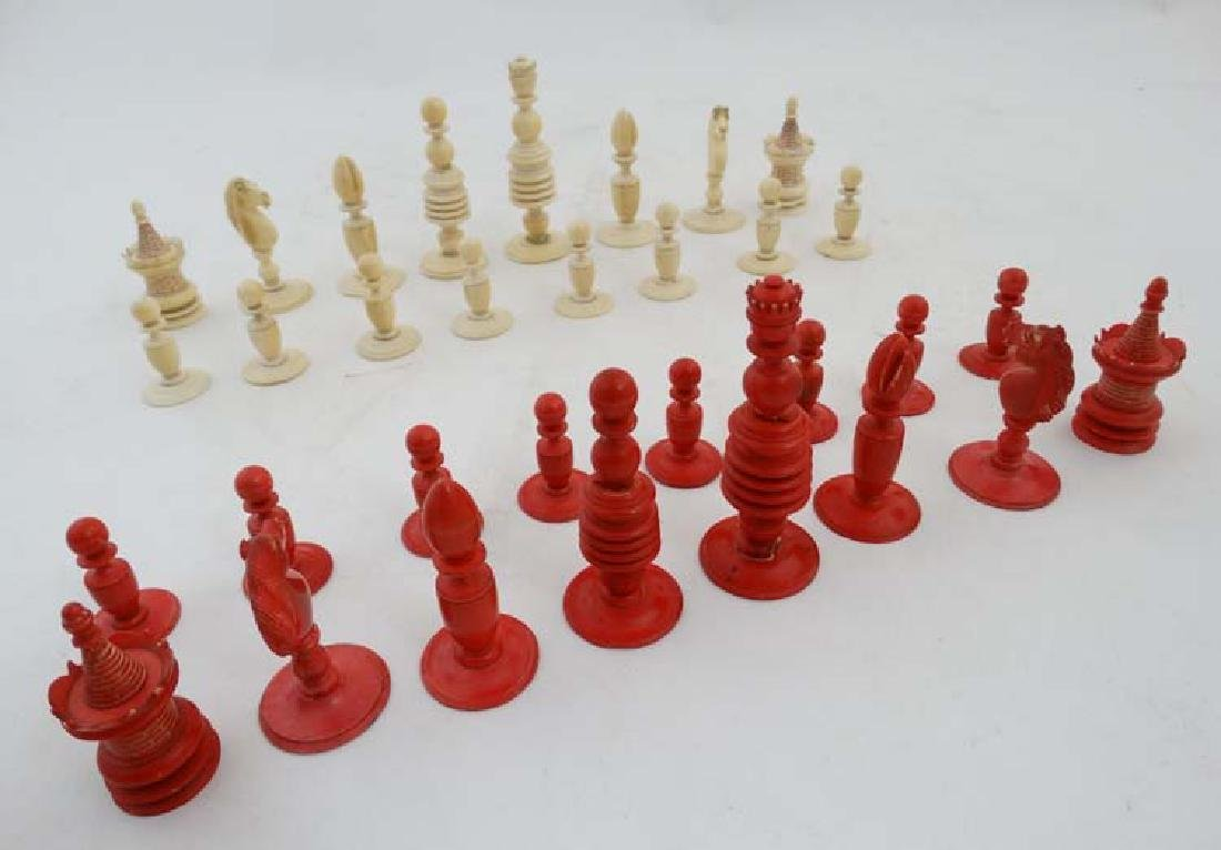 A late 19th C complete set of chess pieces made from