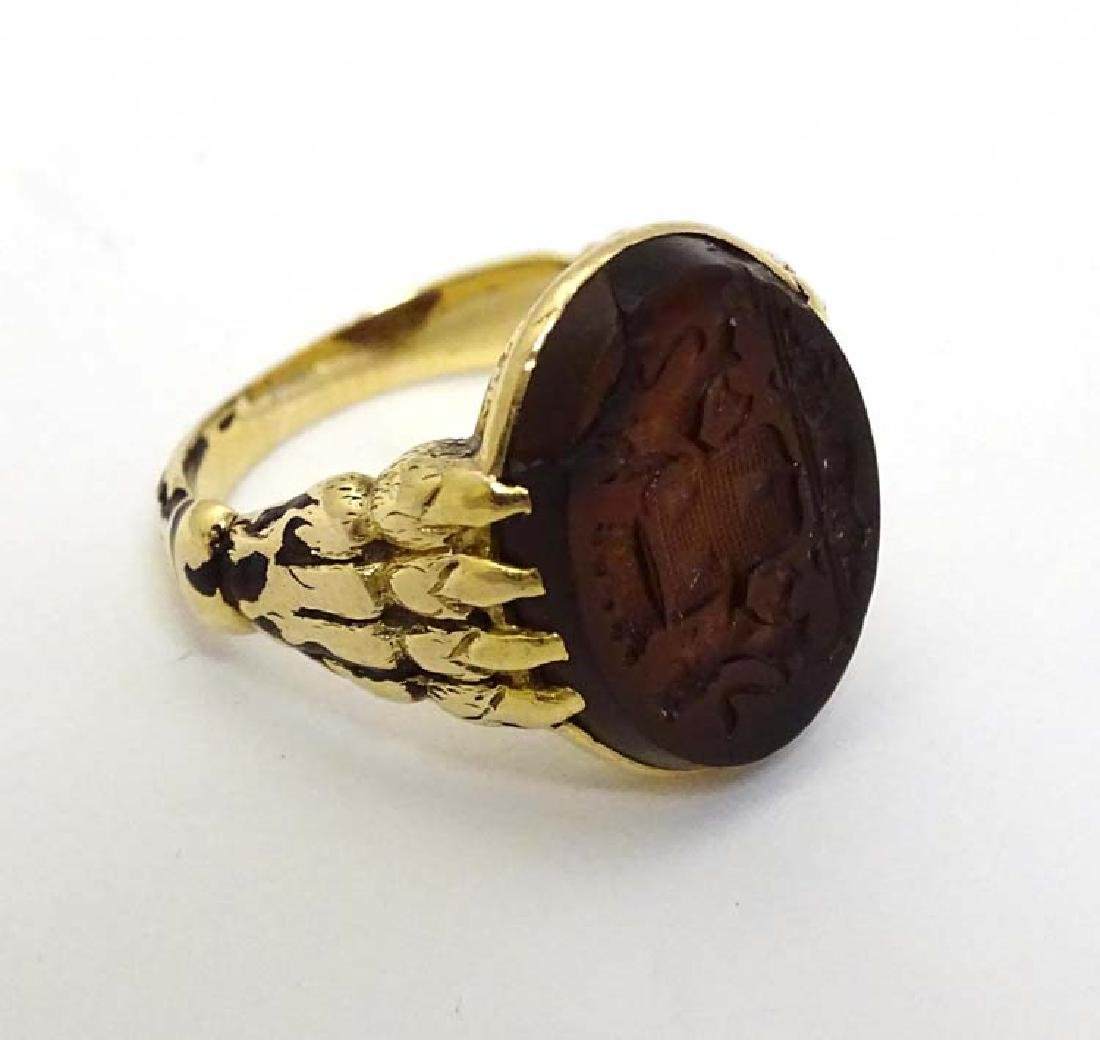 A 19thC seal ring having carved carnealian seal to