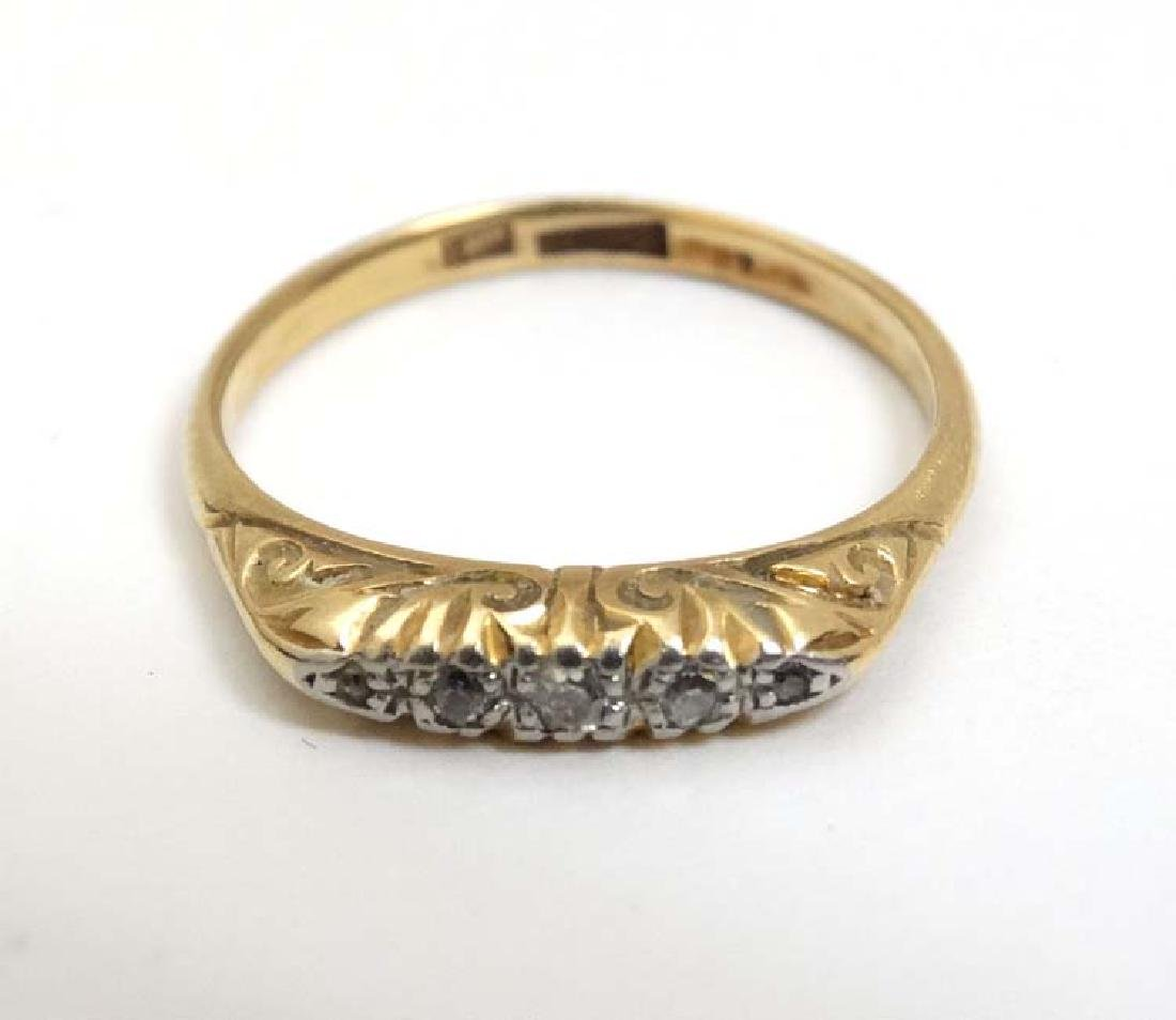 An 18ct gold ring set with 5 diamonds in a linear