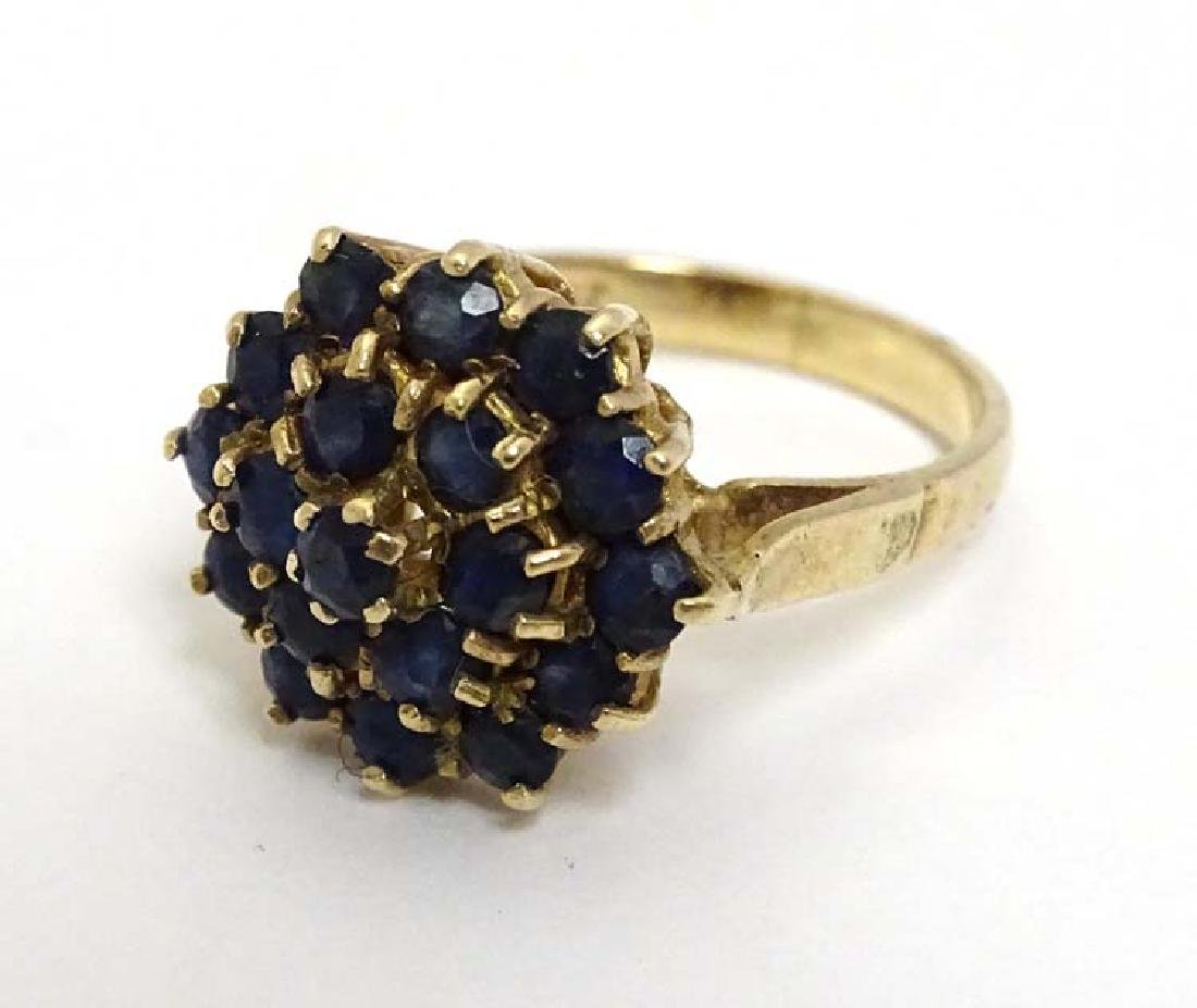 A 9ct gold ring set with sapphire cluster