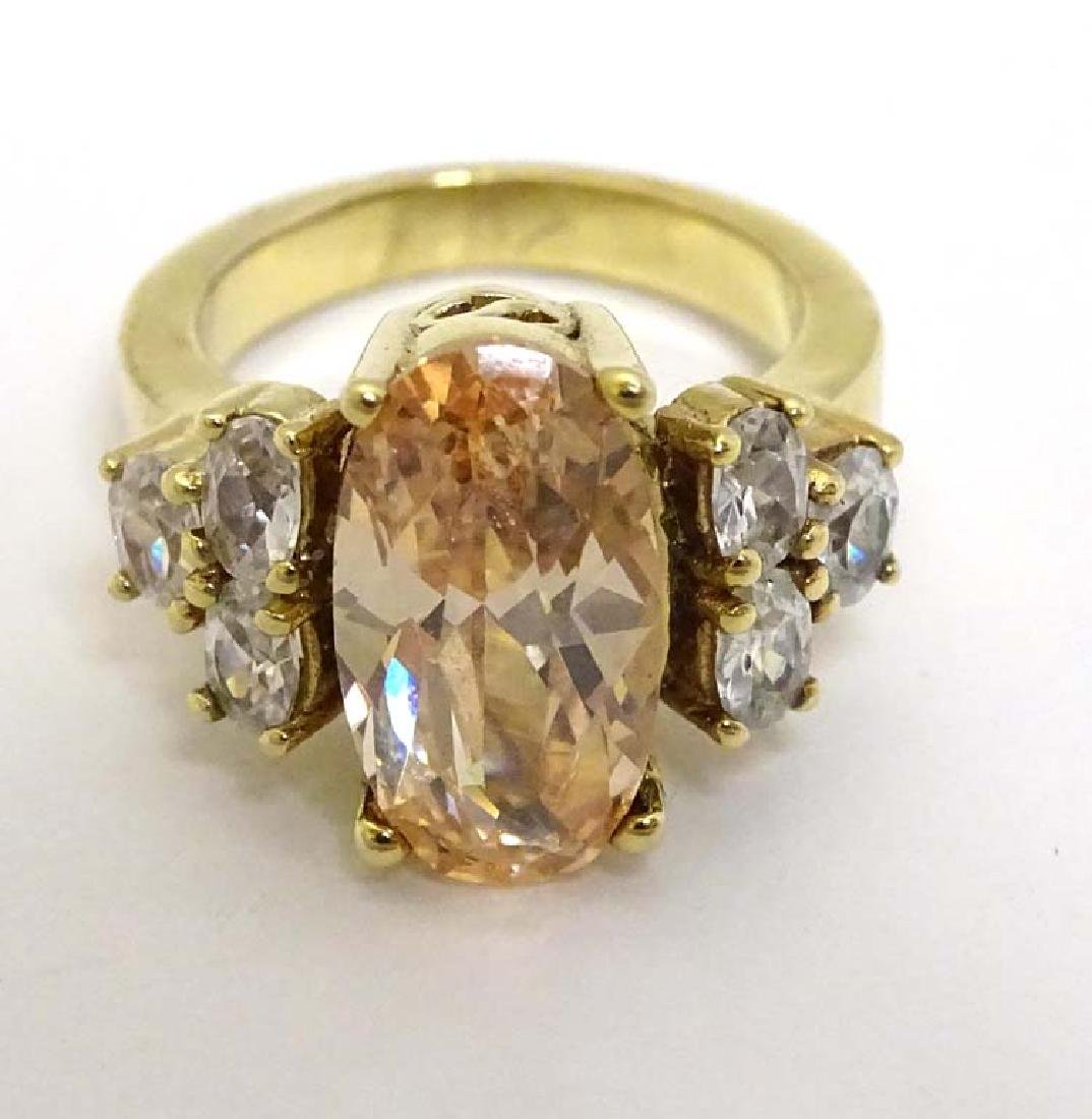 A gilt metal dress / cocktail ring set with amber