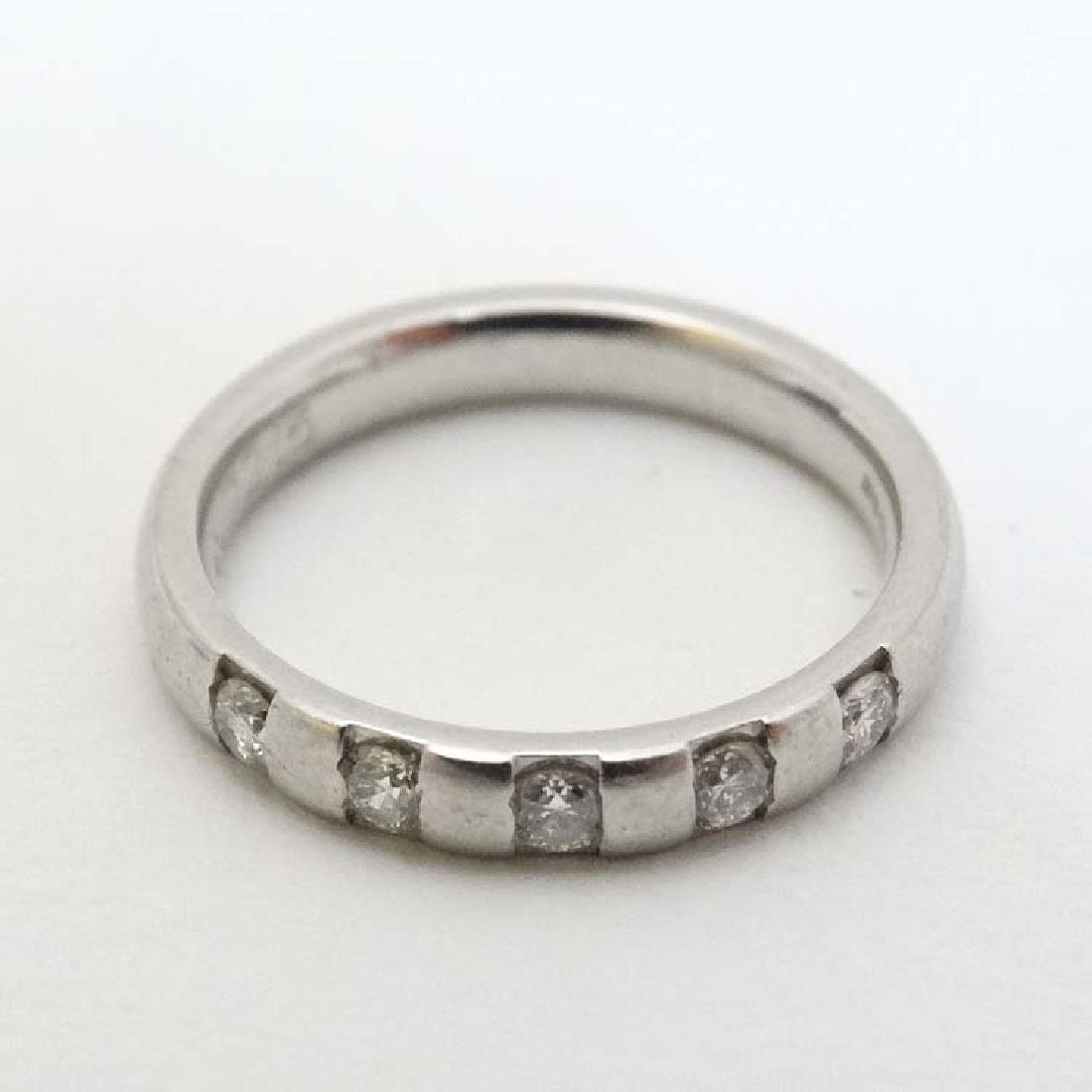 A platinum ring set with 5 diamonds
