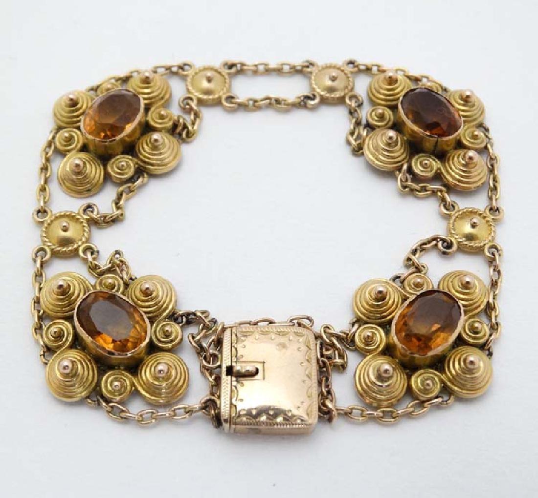 A 9ct gold and gilt metal bracelet set with 5 ciritine