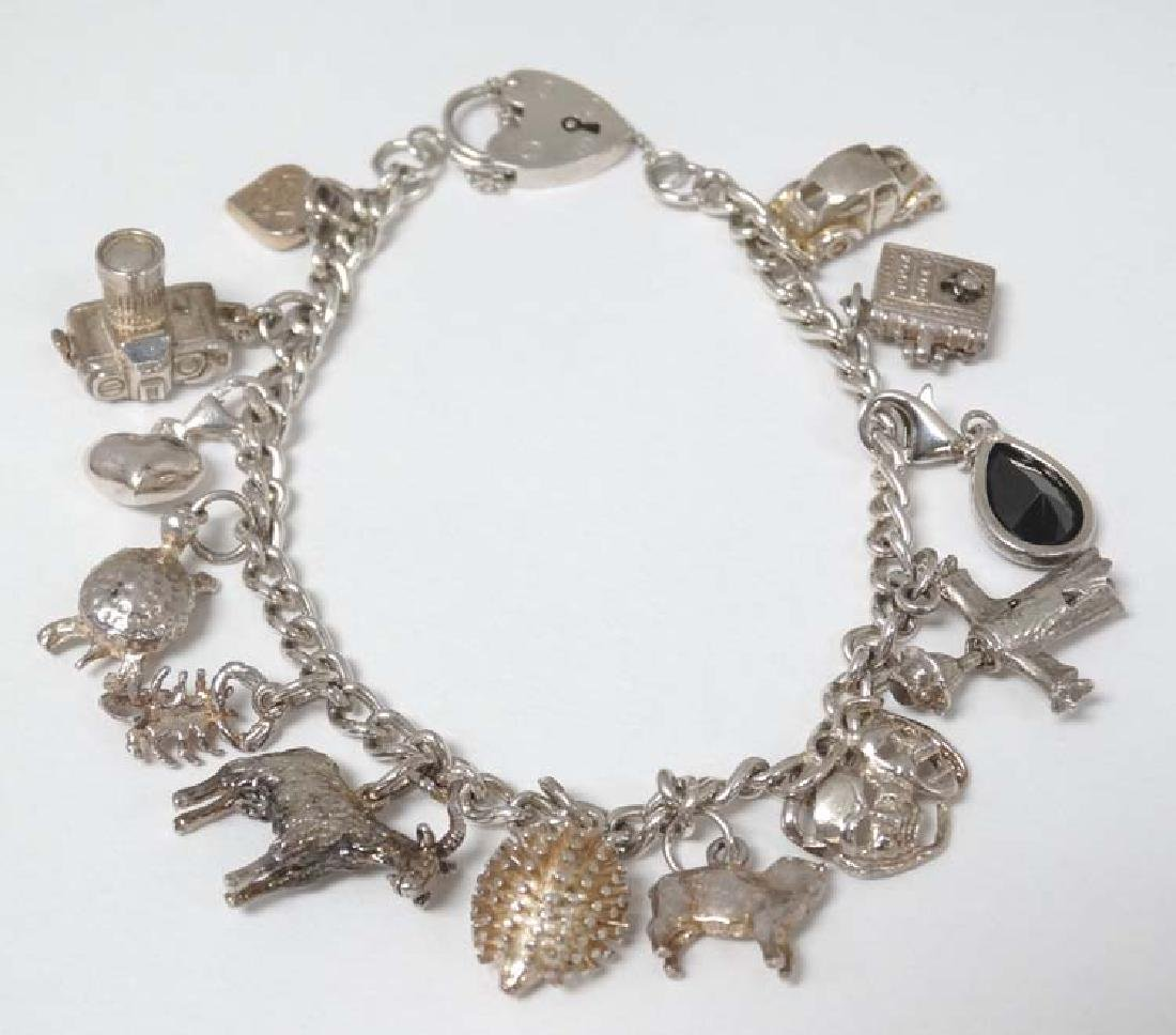 A silver charm bracelet with various silver and silver