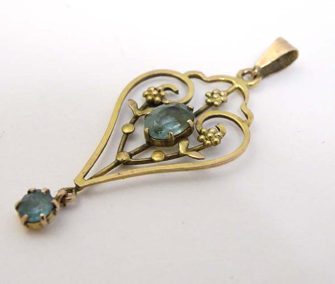 A 9ct gold pendant in the Art Nouveau style set with