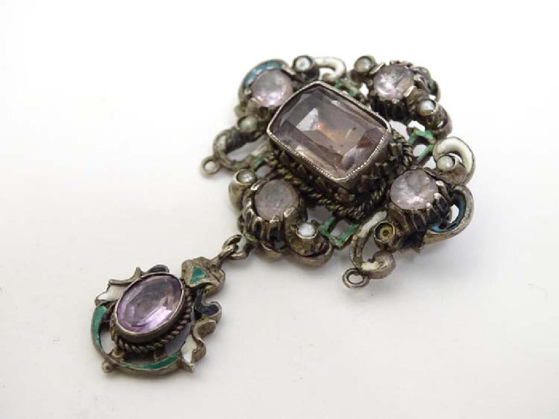 A white metal brooch in the Austro-Hungarian style set