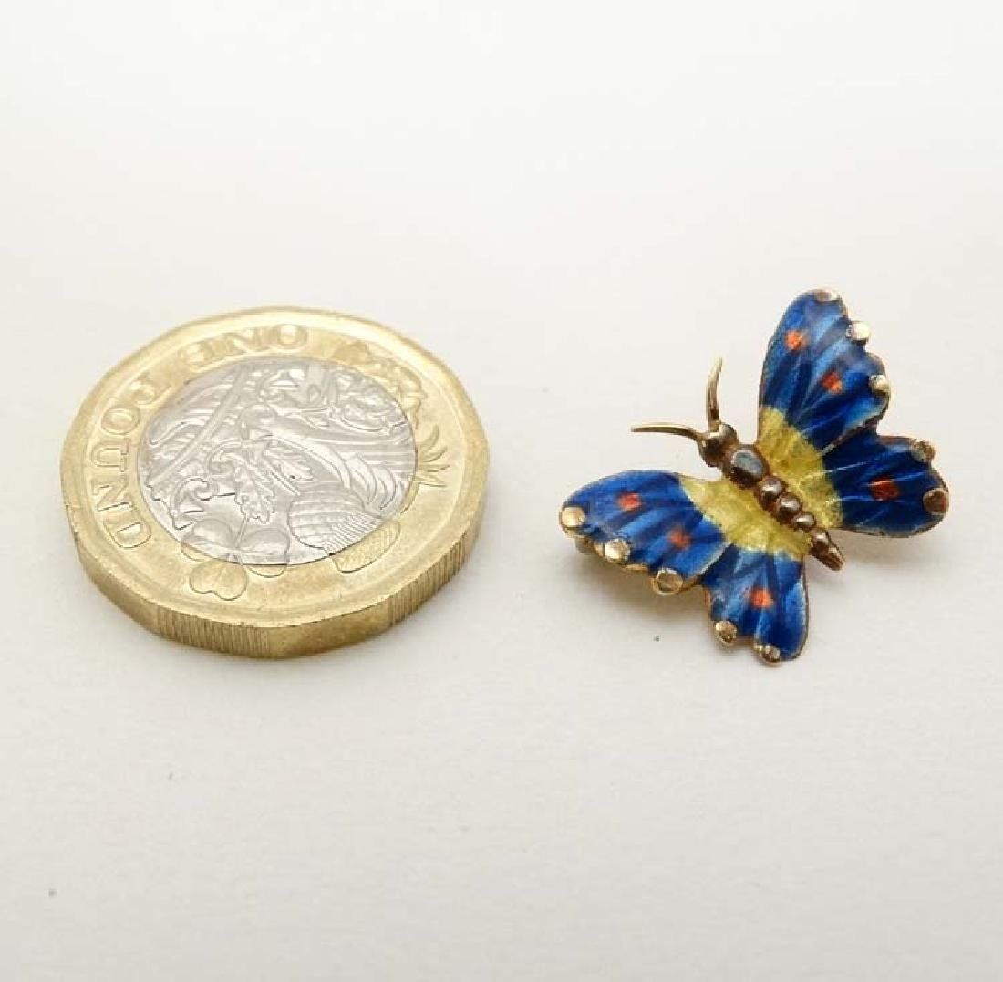 A gold brooch formed as a butterfly with enamel