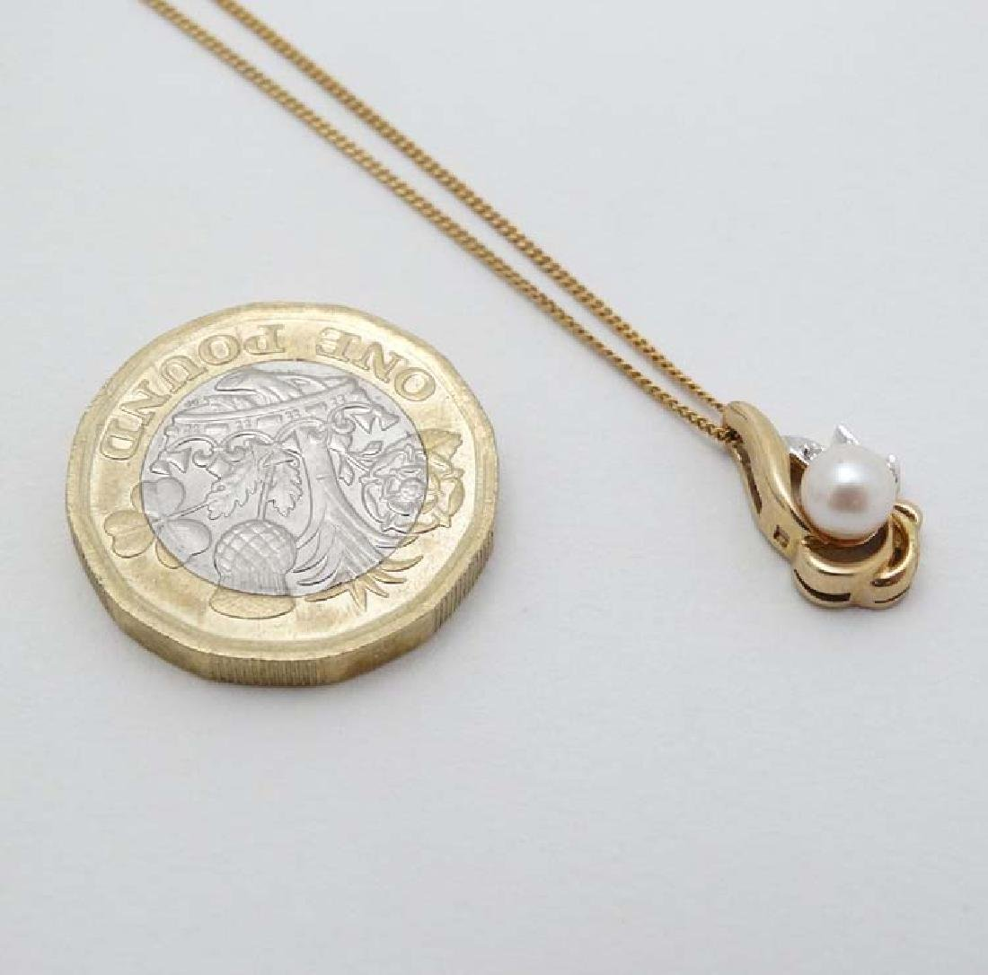 A 9ct gold pendant and chain, the pendant set with