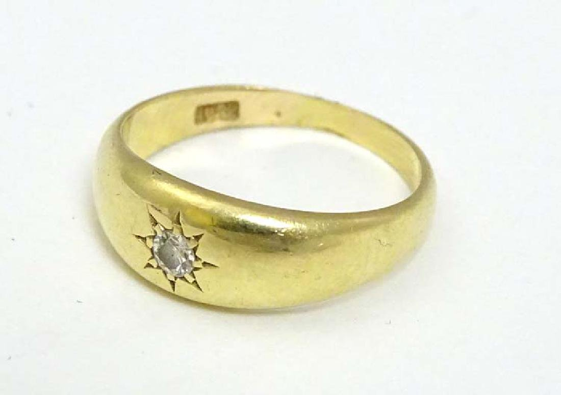 An 18ct gold ring set with diamond