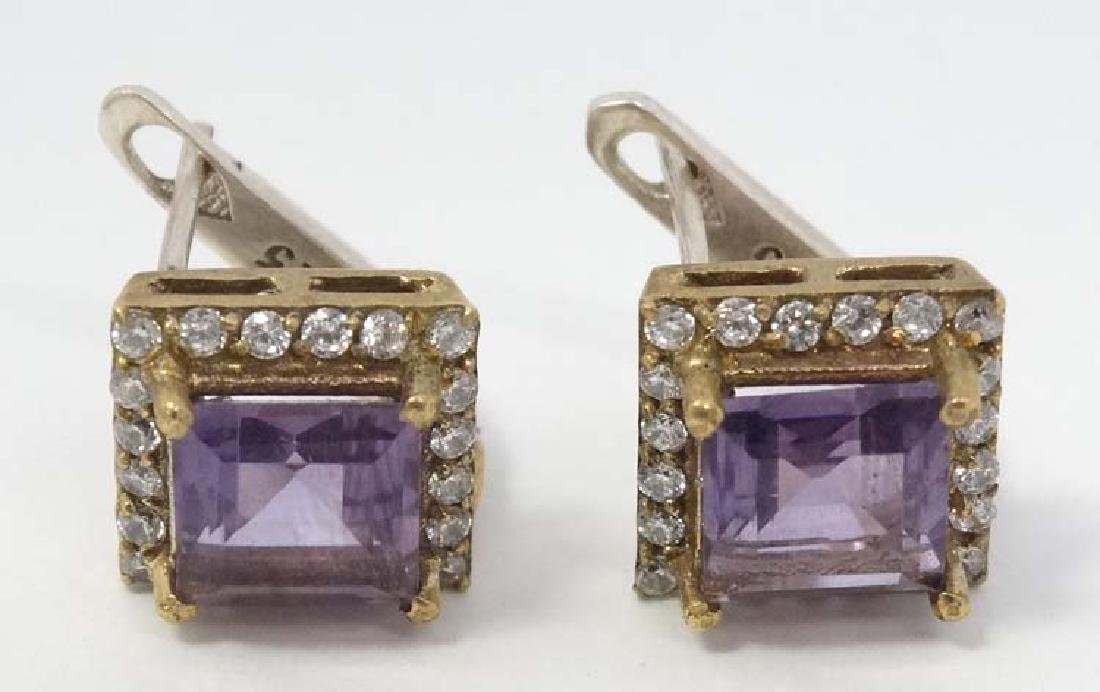 A pair of silver gilt earrings set with amethysts