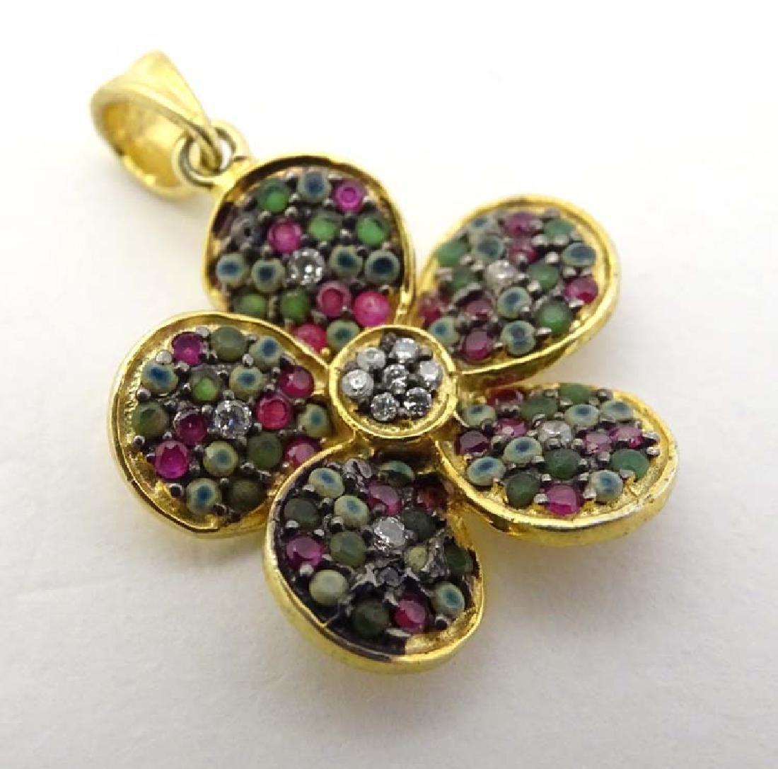 Matching to previous lot : A gilt metal pendant set