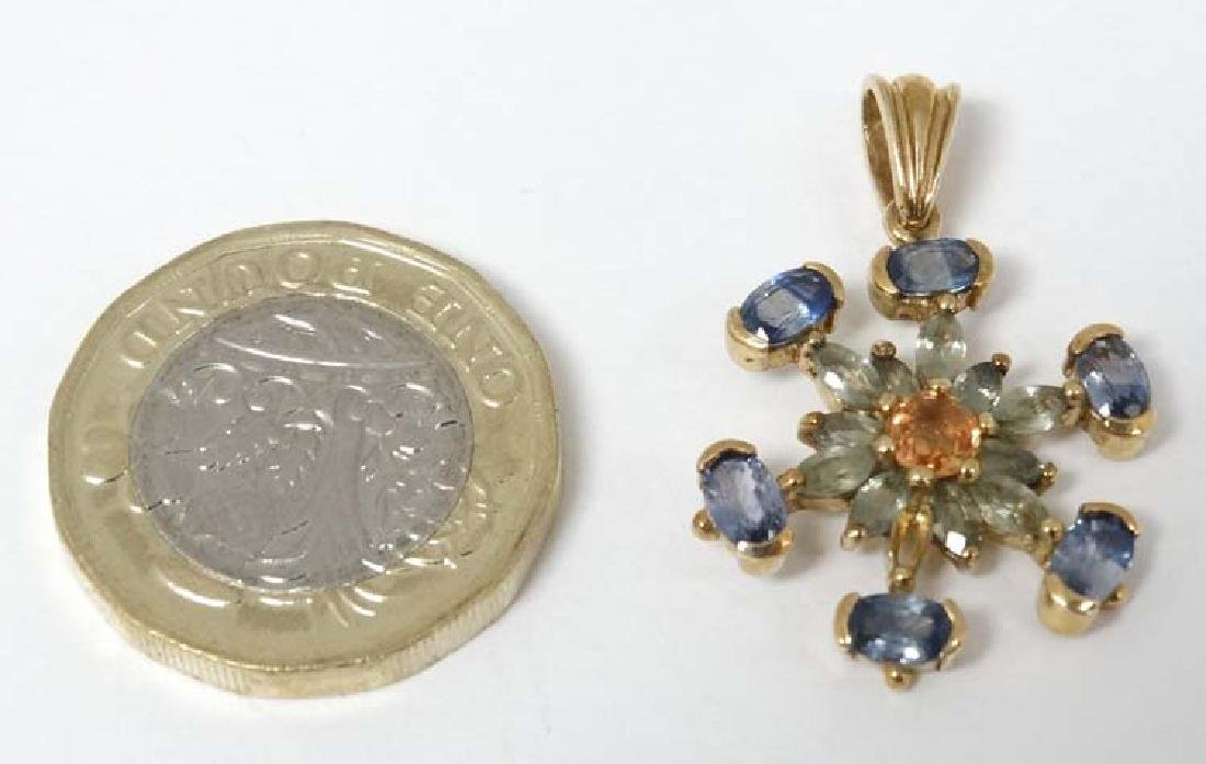 A 9ct gold pendant set with blue green and amber
