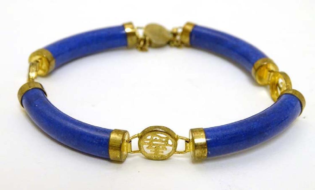 An Oriental gilt metal and lapis Lazuli bracelet with