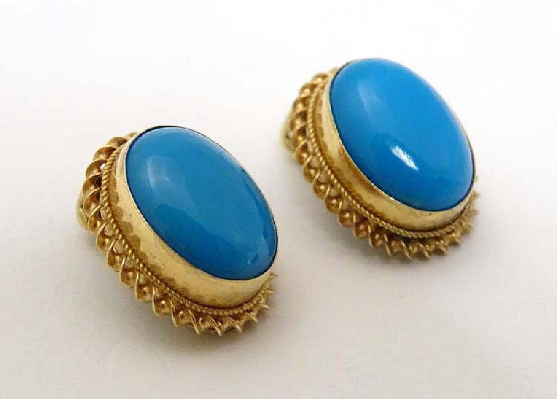 A pair of 9ct gold clip earrings set with turquoise