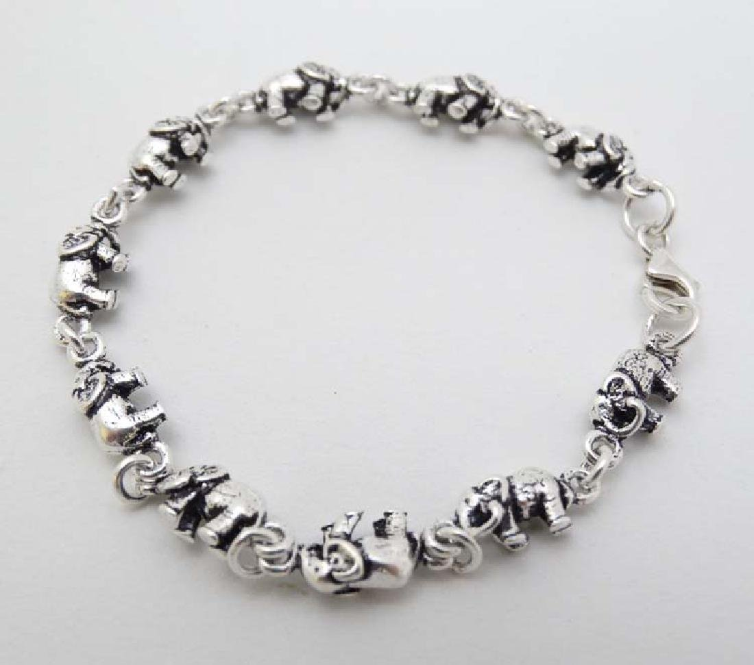 A silver bracelet with elephant decoration approx 6''