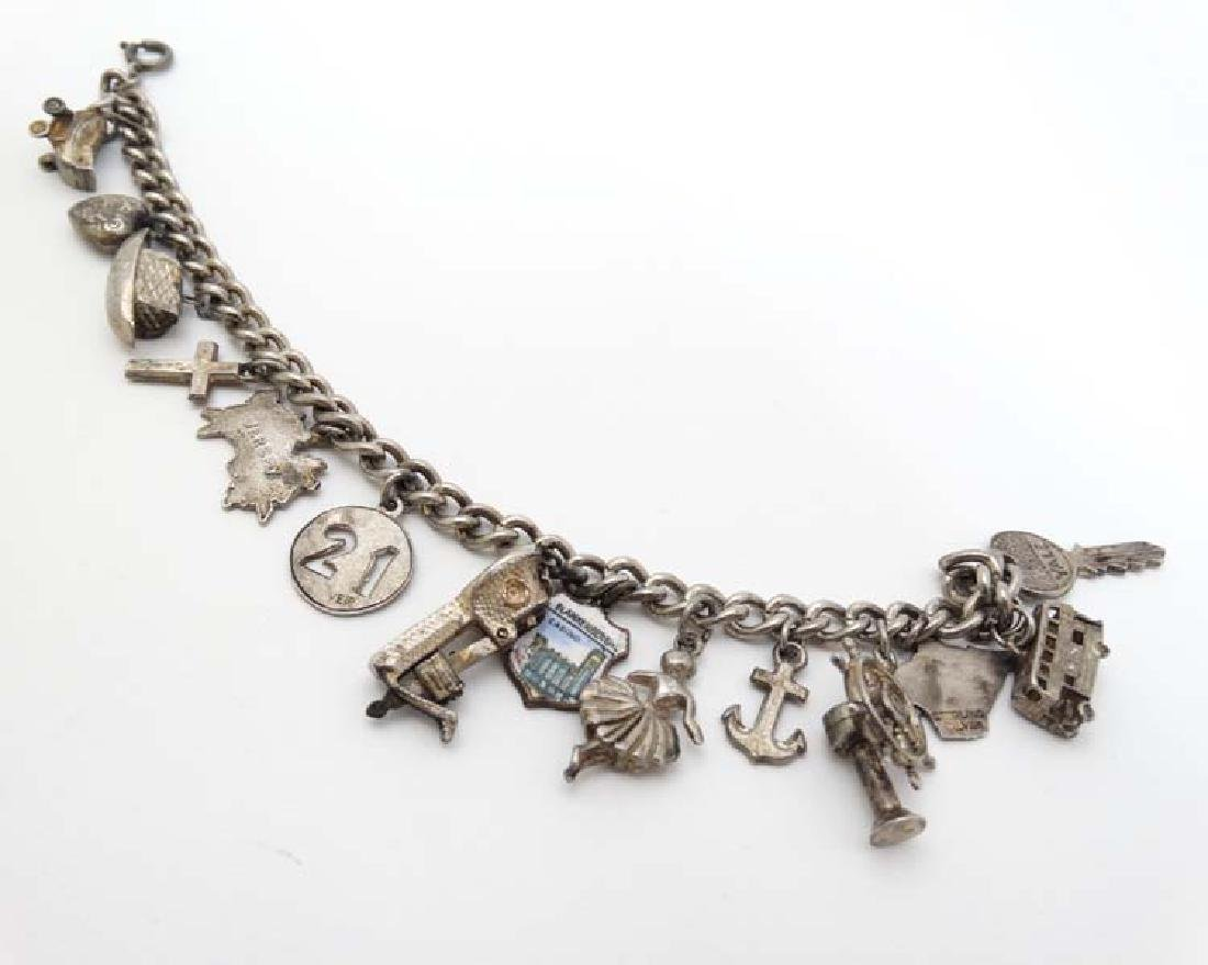 A silver charm bracelet set with various silver and