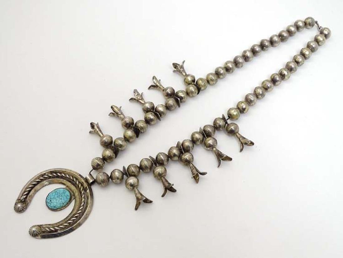 Native American jewellery: A mid 20thC white metal and