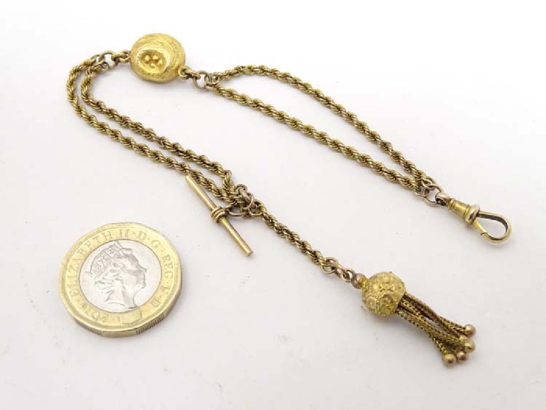 9ct gold Pocketwatch chain : an ornate pocketwatch