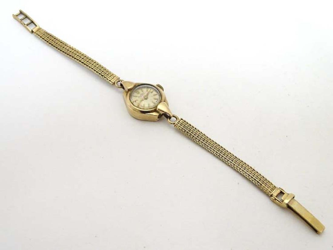 9ct gold ladies watch : A Bingtima Star 15 jewel manual
