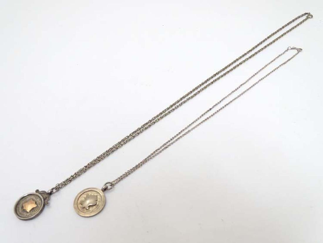 2 white metal necklace chains each with a Hall marked