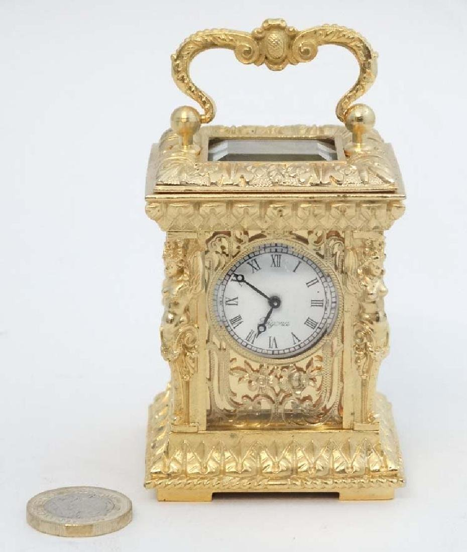 Miniature gilded carriage clock : an ornate cast case