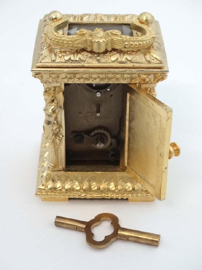 Miniature gilded carriage clock : an ornate cast case - 2