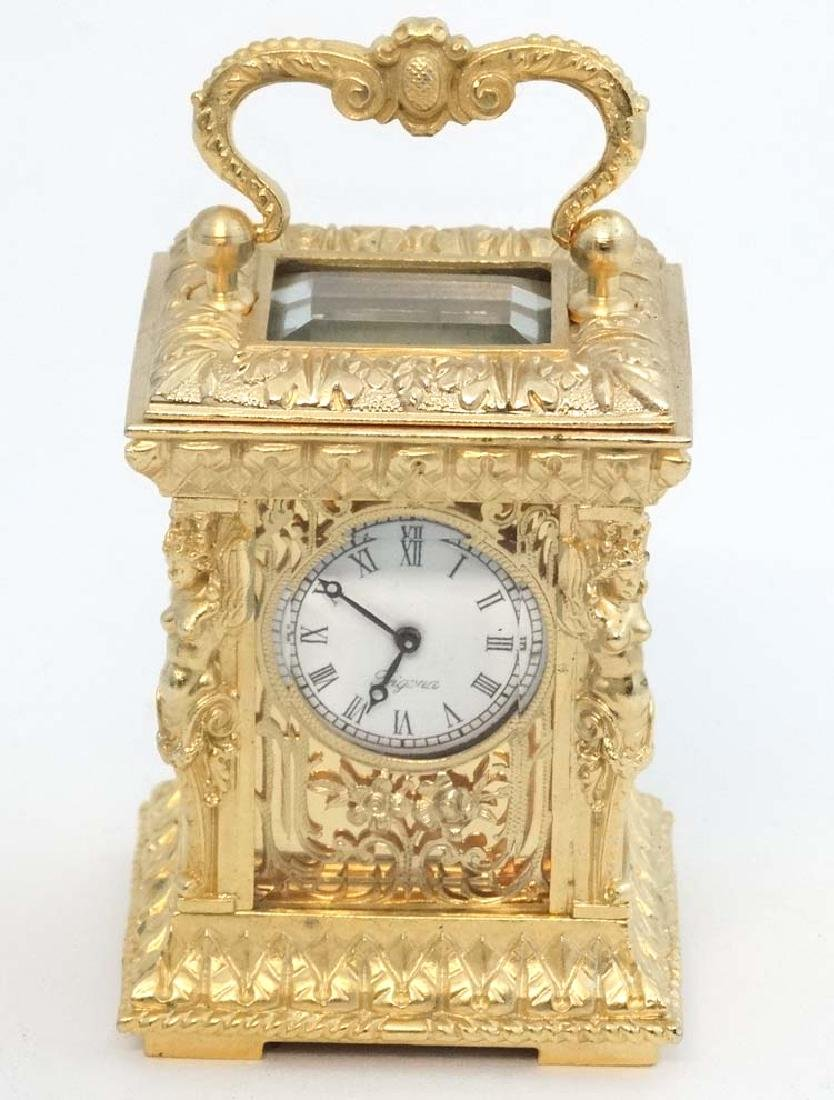 Miniature gilded carriage clock : an ornate cast case - 4