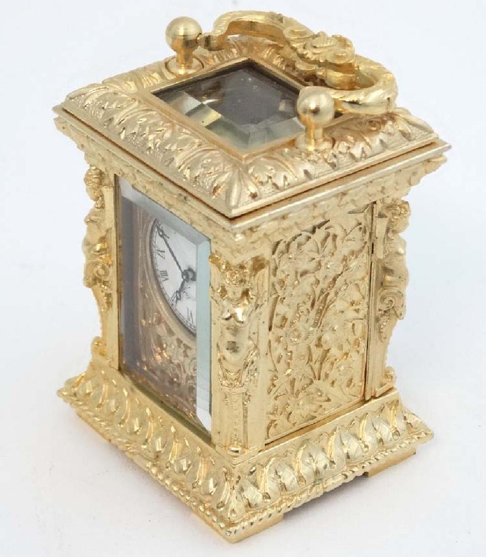 Miniature gilded carriage clock : an ornate cast case - 5