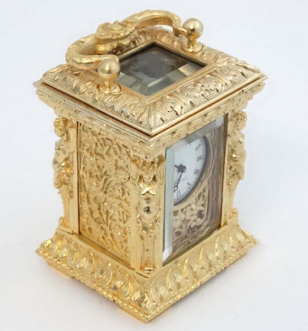 Miniature gilded carriage clock : an ornate cast case - 6