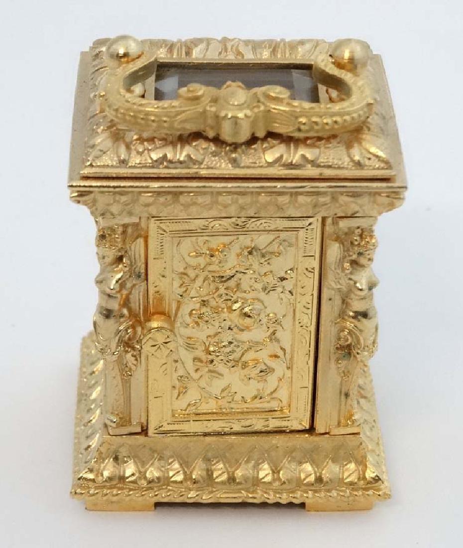 Miniature gilded carriage clock : an ornate cast case - 7