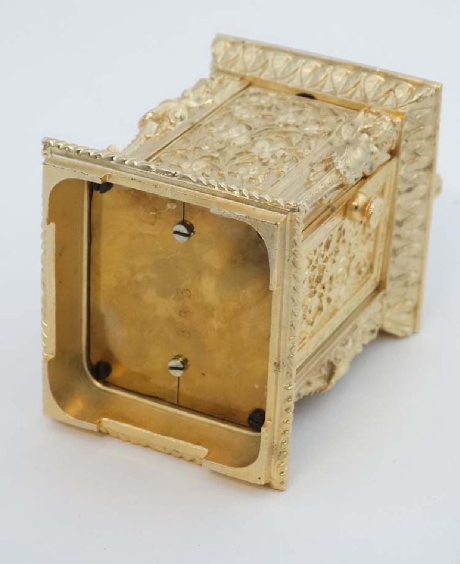 Miniature gilded carriage clock : an ornate cast case - 8