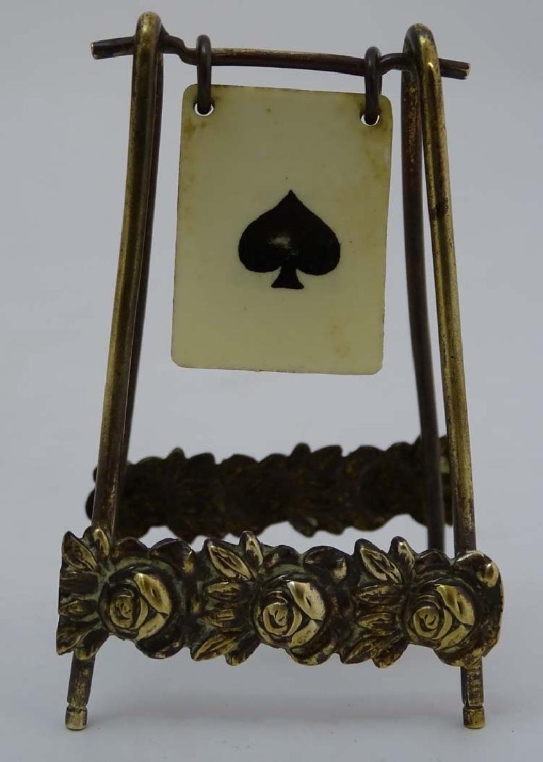 A brass playing card trump marker, 3'' high - 2