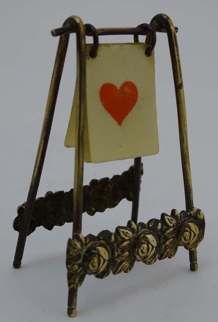 A brass playing card trump marker, 3'' high - 3