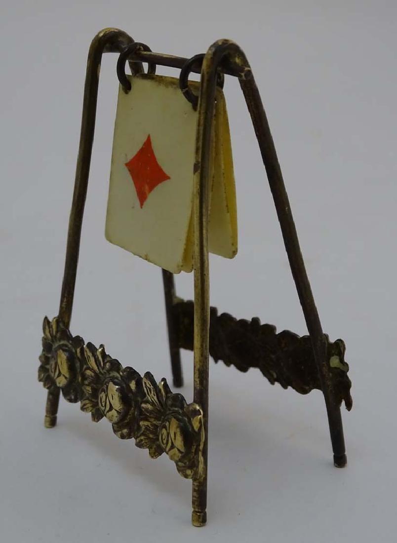 A brass playing card trump marker, 3'' high - 4