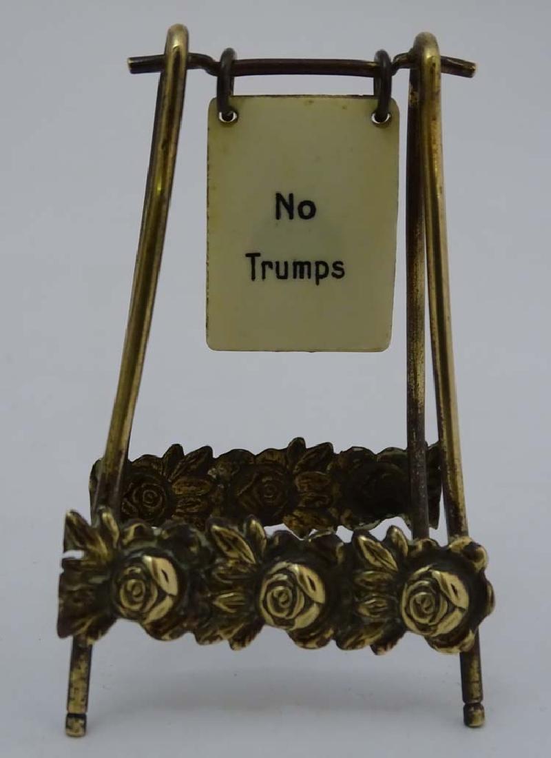 A brass playing card trump marker, 3'' high - 5