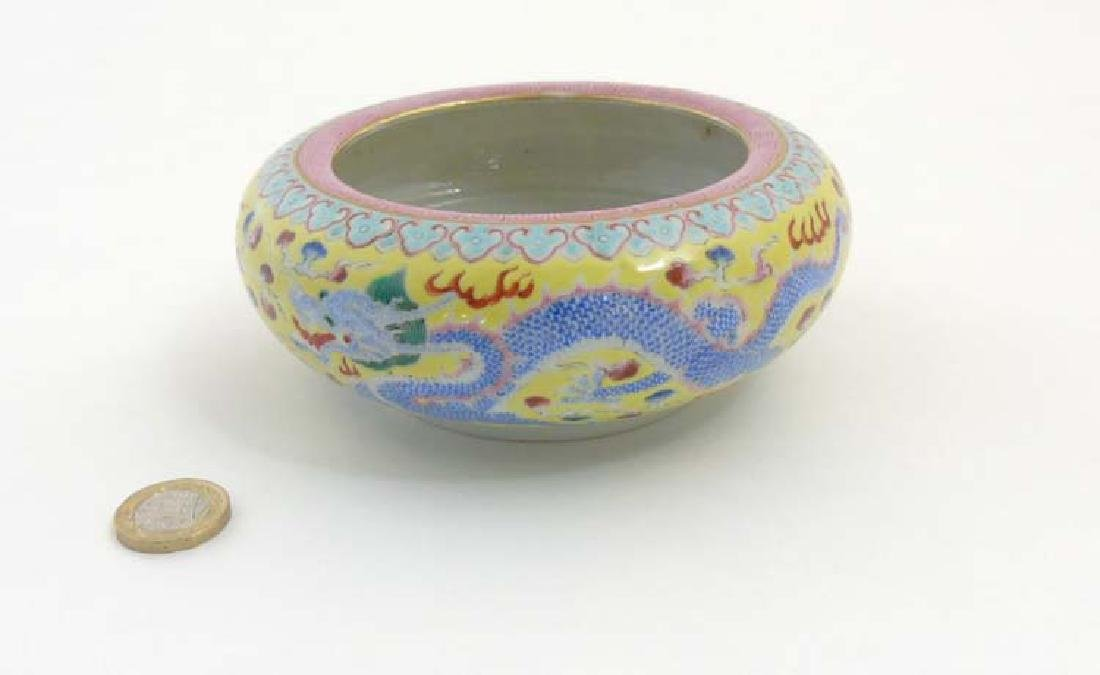 A Chinese enamelled famille rose dragon brush pot,