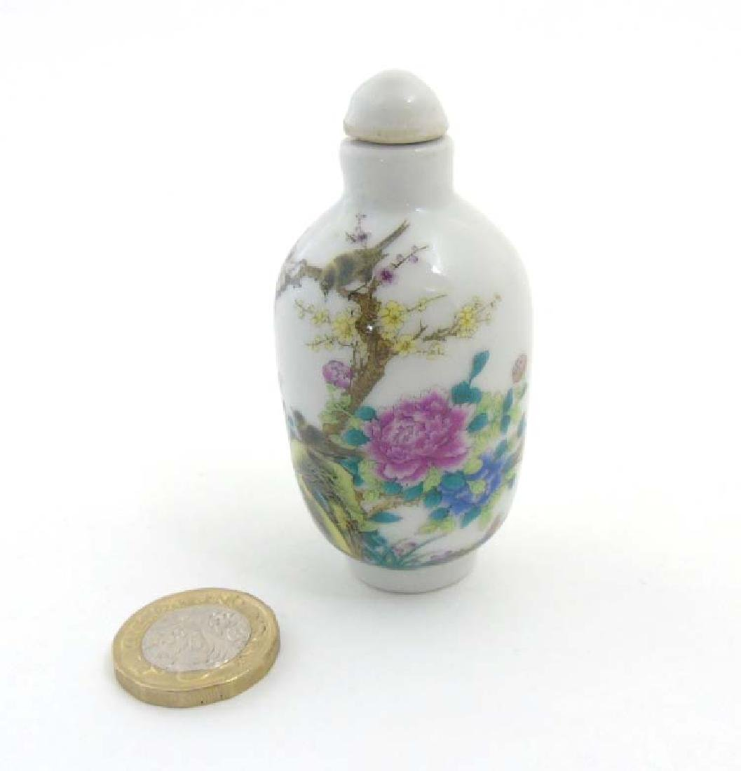 An Oriental Famille Rose snuff bottle depicting a