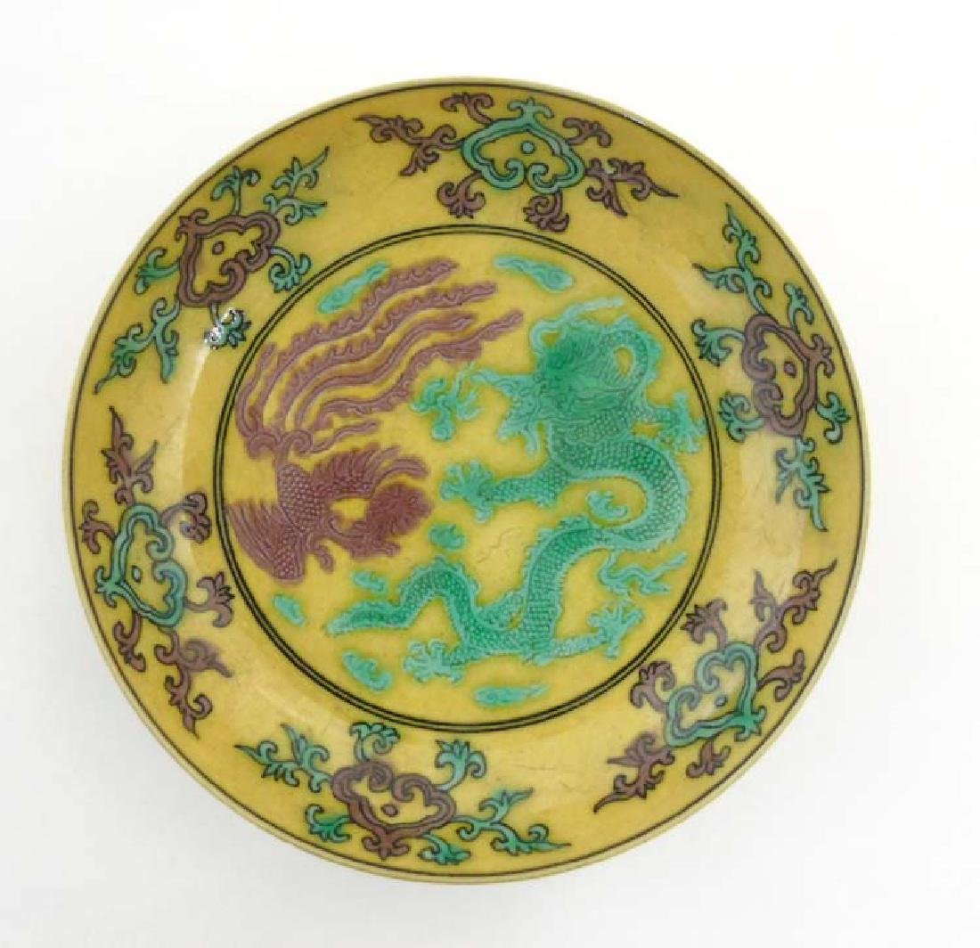 An Imperial yellow '' dragon'' dish , decorated with  5
