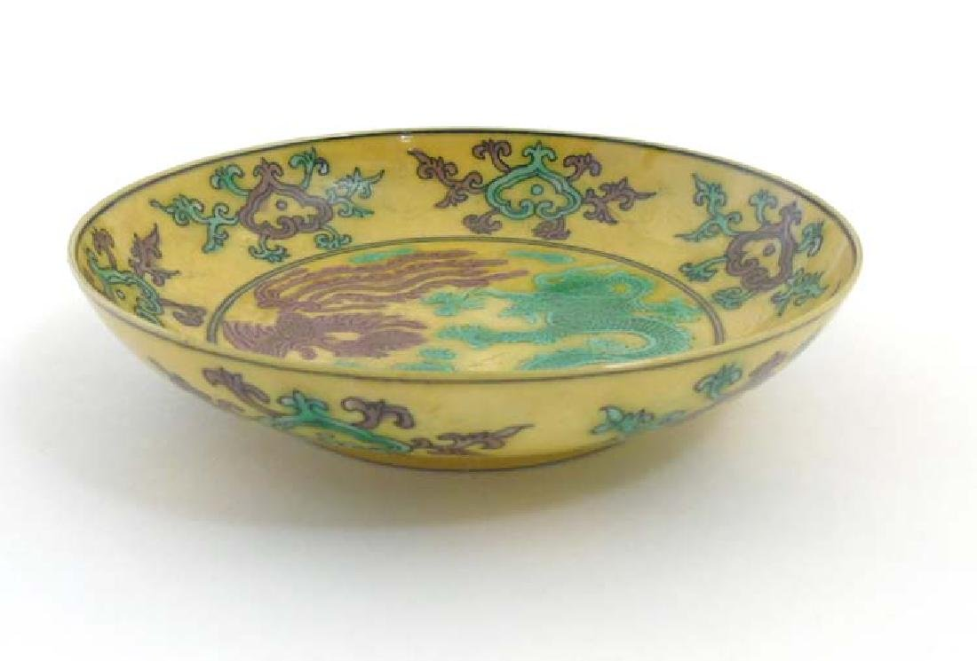 An Imperial yellow '' dragon'' dish , decorated with  5 - 4