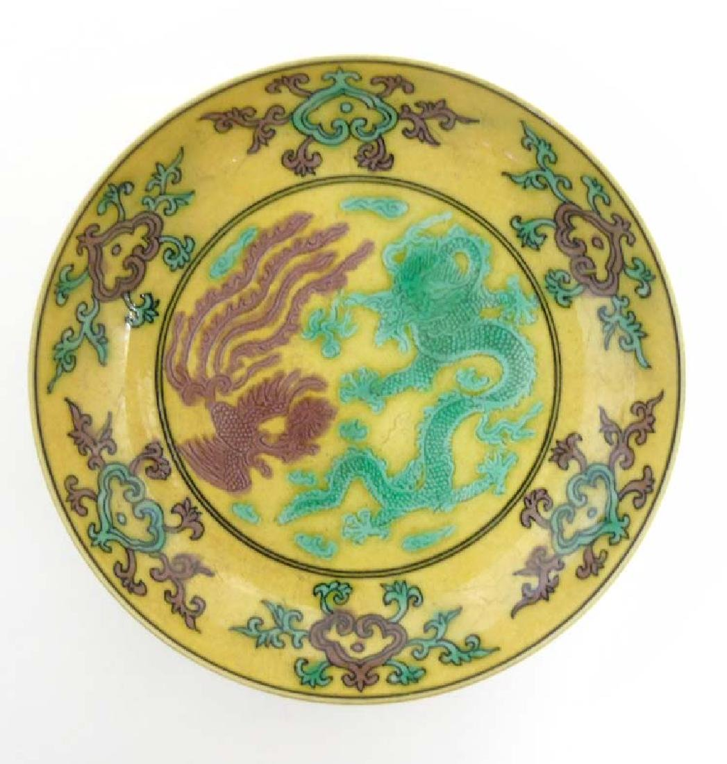 An Imperial yellow '' dragon'' dish , decorated with  5 - 5