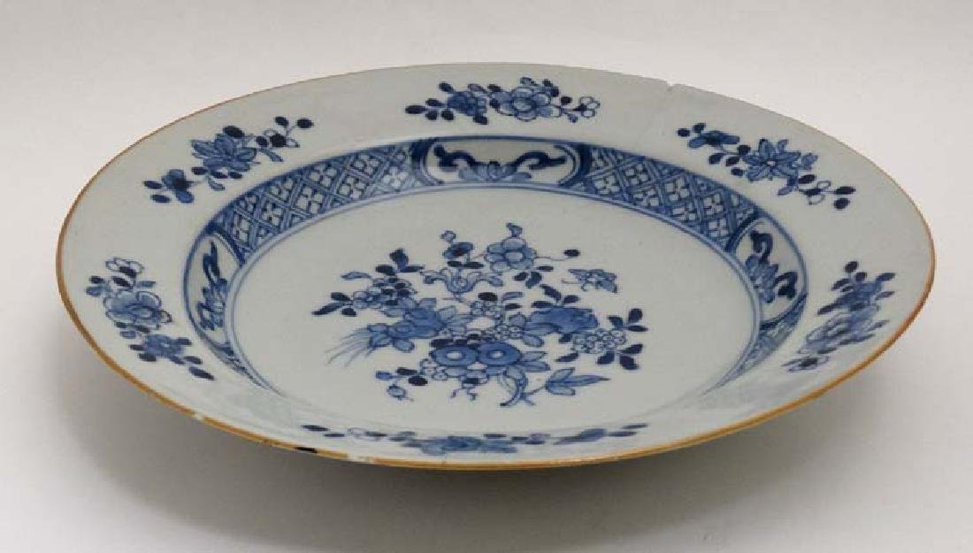 A blue and white Chinese ceramic plate. Decorated with