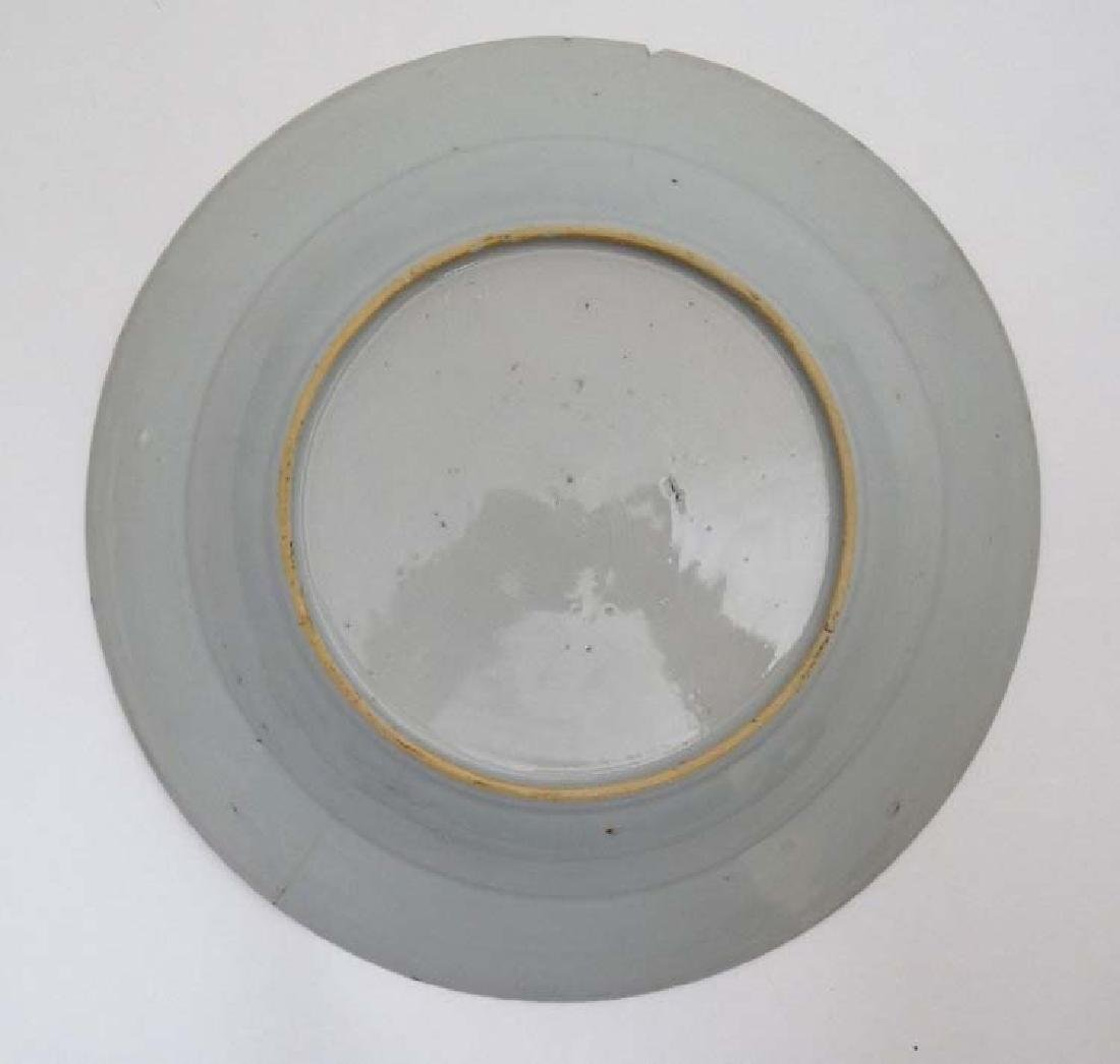 A blue and white Chinese ceramic plate. Decorated with - 5