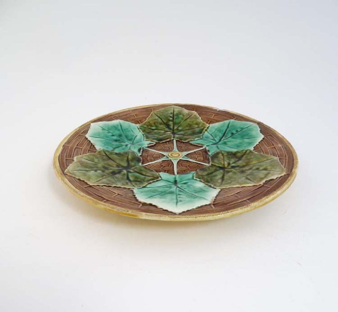 A 20th C majolica plate with 6 green leaf decoration, - 2