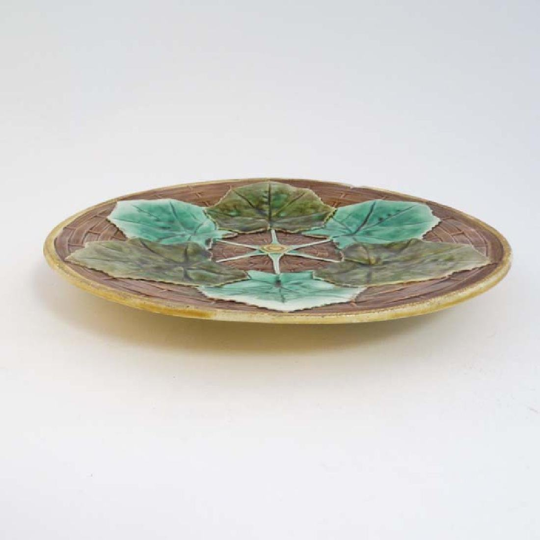 A 20th C majolica plate with 6 green leaf decoration, - 3