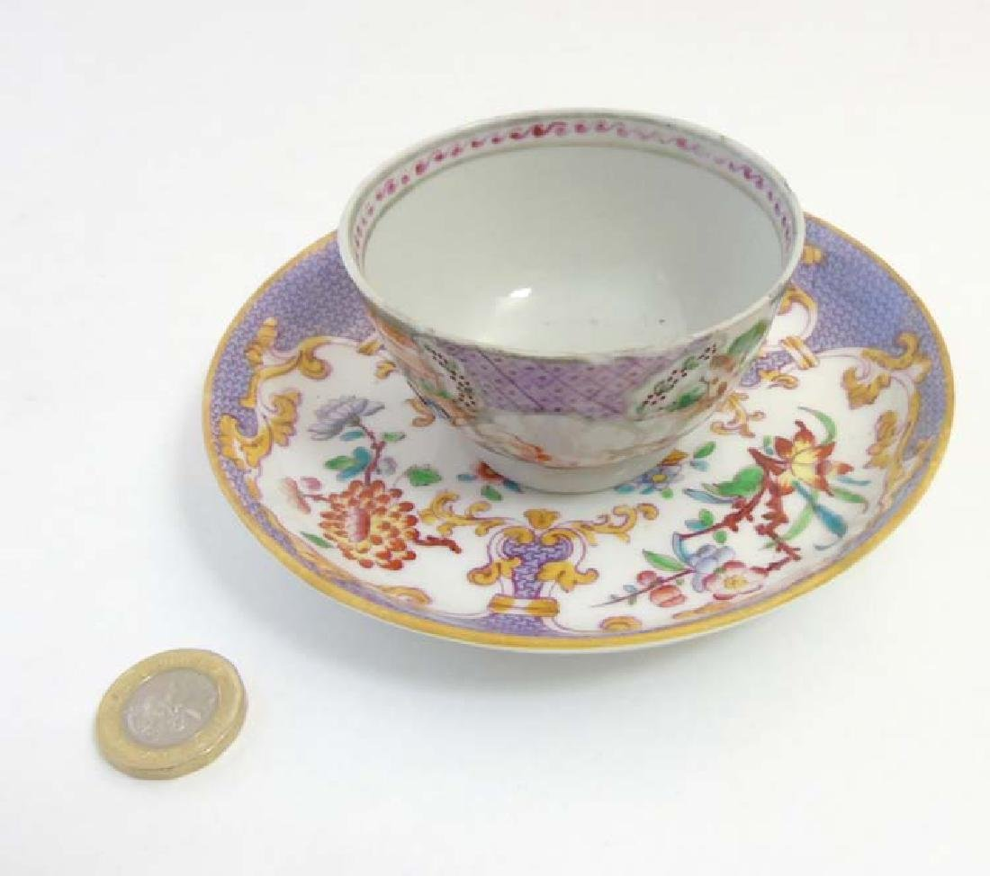 A matched tea cup and saucer comprising a 19thC Minton