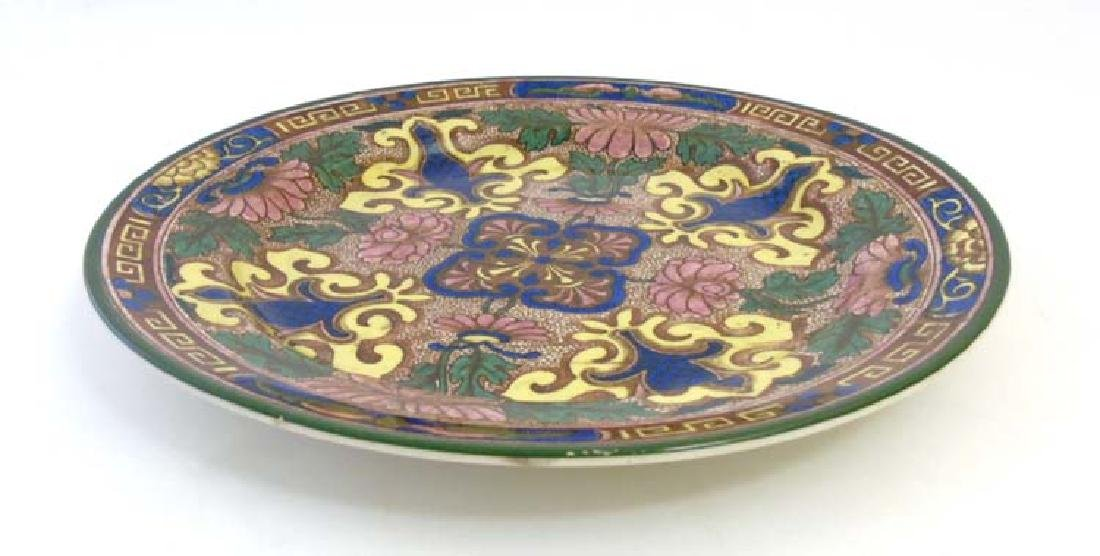 An early 20thC Royal Doulton plate, design D3087, - 3