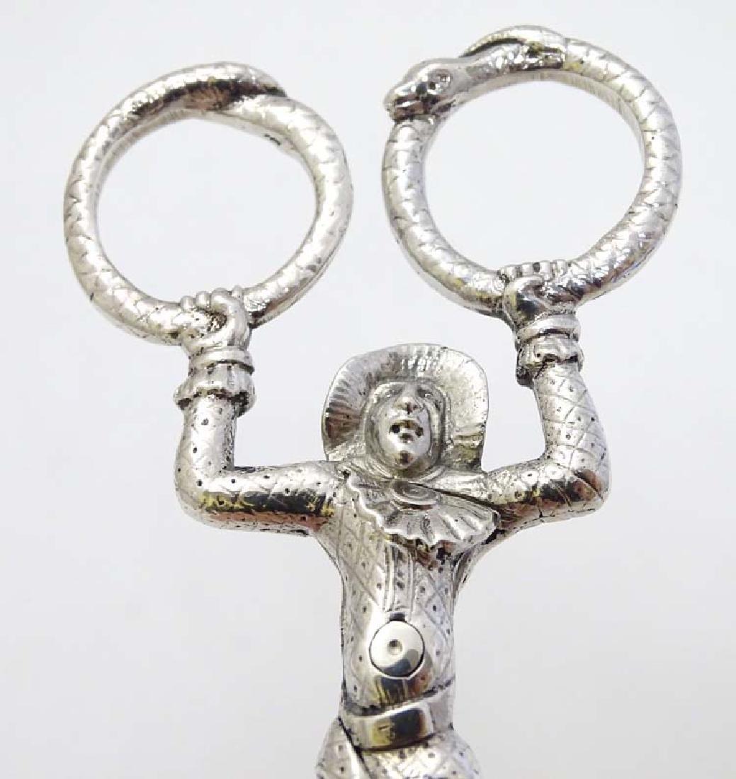 A pair of Victorian silver novelty harlequin sugar - 2