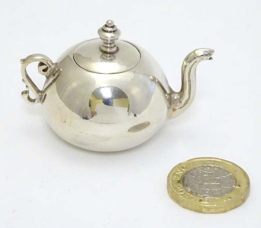 A .925 silver miniature model of a teapot 1 1/2'' high