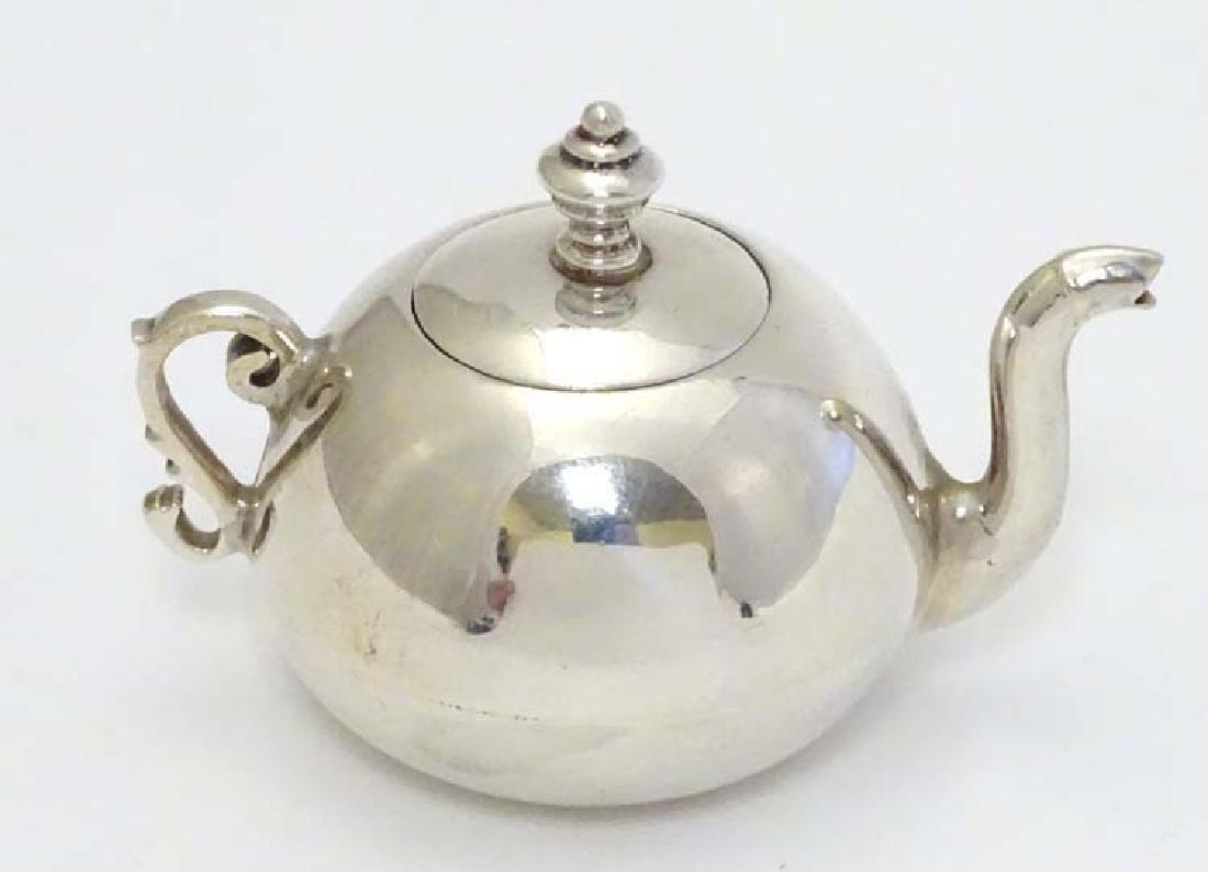 A .925 silver miniature model of a teapot 1 1/2'' high - 3